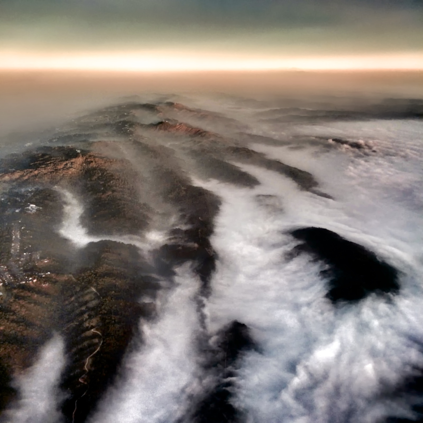 http://thedigitalstory.com/2015/01/16/Fog-Over-Valleys.jpg