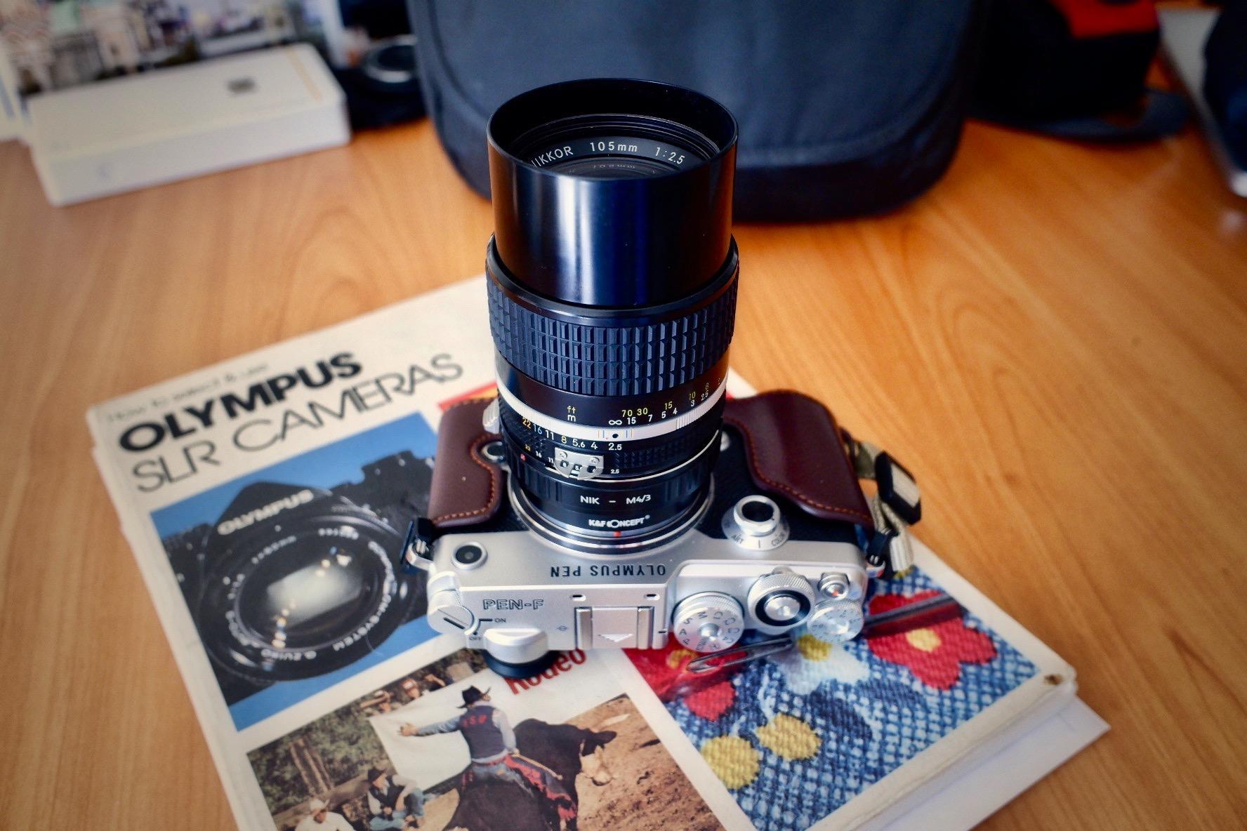 http://thedigitalstory.com/2019/02/22/Nikon-105mm-PEN-F.jpg